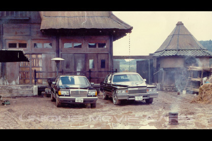 Benz and Cadillac on set